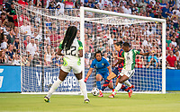 AUSTIN, TX - JUNE 16: Christen Press #23 of the USWNT fights for the ball with Chidinma Okeke #14 of Nigeria during a game between Nigeria and USWNT at Q2 Stadium on June 16, 2021 in Austin, Texas.