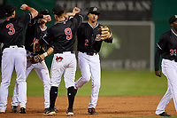 Batavia Muckdogs Gerardo Nunez (2) and Andrew Turner (9) celebrate a victory during a NY-Penn League game against the State College Spikes on July 2, 2019 at Dwyer Stadium in Batavia, New York.  Batavia defeated State College 1-0.  (Mike Janes/Four Seam Images)