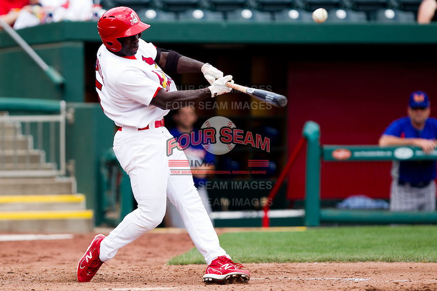 Jermaine Curtis (5) of the Springfield Cardinals makes contact on a pitch during a game against the Midland RockHounds on April 19, 2011 at Hammons Field in Springfield, Missouri.  Photo By David Welker/Four Seam Images