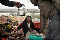 Sheela at her tea stall on waste ground near Nehru Place. Sheela came to Delhi in 1981 from Rajasthan with her husband and three children. Over the years they all died leaving her alone.