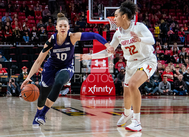 COLLEGE PARK, MD - JANUARY 26: Lindsey Pulliam #10 of Northwestern dribbles past Blair Watson #22 of Maryland during a game between Northwestern and Maryland at Xfinity Center on January 26, 2020 in College Park, Maryland.