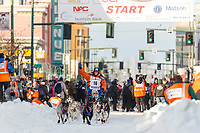 Cindy Abbott leaves the 4th avenue start during the ceremonial start of the 2019 Iditarod in downtown Anchorage, Alaska on Saturday March 2.<br /> <br /> Photo by Jeff Schultz/  (C) 2019  ALL RIGHTS RESERVED