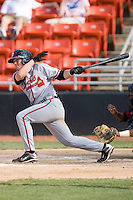 Jordan Kreke #10 of the Rome Braves follows through on his swing against the Hickory Crawdads at  L.P. Frans Stadium May 23, 2010, in Hickory, North Carolina.  The Rome Braves defeated the Hickory Crawdads 5-1.  Photo by Brian Westerholt / Four Seam Images