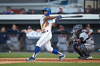 Kevon Jackson (11) of the Burlington Royals follows through on his swing against the Danville Braves at Burlington Athletic Stadium on July 13, 2019 in Burlington, North Carolina. The Royals defeated the Braves 5-2. (Brian Westerholt/Four Seam Images)