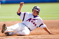 Jake Mahon (25) of the Evansville Purple Aces slides into third base during a game against the Indiana State Sycamores in the 2012 Missouri Valley Conference Championship Tournament at Hammons Field on May 23, 2012 in Springfield, Missouri. (David Welker/Four Seam Images)