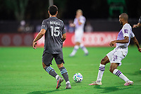LAKE BUENA VISTA, FL - AUGUST 06: Michael Boxall #15 of Minnesota United FC dribbles the ball during a game between Orlando City SC and Minnesota United FC at ESPN Wide World of Sports on August 06, 2020 in Lake Buena Vista, Florida.