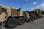 "American soldiers with the 15th Engineer Battalion help unload $28.5 million of equipment for a two week-long NATO exercise at the Drawsko Pomorskie Training Area in Poland on June 10, 2015.  NATO is engaged in a multilateral training exercise ""Saber Strike,"" the first time Poland has hosted such war games, involving the militaries of Canada, Denmark, Germany, Poland, and the United States."