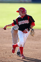 Batavia Muckdogs second baseman Matt Valaika (8) avoids a tag during the first game of a double header vs. the Connecticut Tigers at Dwyer Stadium in Batavia, New York July 10, 2010.   Batavia defeated Connecticut 5-3.  Photo By Mike Janes/Four Seam Images