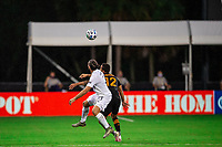 LAKE BUENA VISTA, FL - JULY 23: Emiliano Insua #3 of the LA Galaxy and Niko Hansen #12 of the Houston Dynamo battle for the ball during a game between Los Angeles Galaxy and Houston Dynamo at ESPN Wide World of Sports on July 23, 2020 in Lake Buena Vista, Florida.