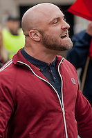 Saturday 05 April 2014<br /> Pictured: A National front supporter growls at anti fascist campaigners as the National front group walk through the town<br /> Re: White Pride and Anti Fascist groups protest in Swansea City Cebtre