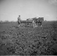Alberta - Man [Robert Brebner?] plowing field and smoking a pipe., 1923<br /> <br /> From the Robert McKay Brebner fonds,