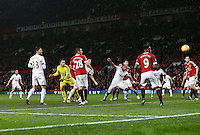 Swansea City goalkeeper Lukasz Fabianski goes close to scoring with a header during the Barclays Premier League match between Manchester United and Swansea City played at Old Trafford, Manchester on January 2nd 2016