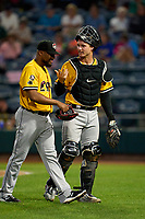 Erie SeaWolves catcher Dillon Dingler (15) talks with pitcher Henry Martinez (32) during a game against the Altoona Curve on September 7, 2021 at Peoples Natural Gas Field in Altoona, Pennsylvania.  (Mike Janes/Four Seam Images)