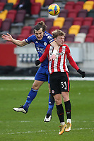 Caglar Soyuncu of Leicester City out jumps Brentford's Jan Zamburek during Brentford vs Leicester City, Emirates FA Cup Football at the Brentford Community Stadium on 24th January 2021