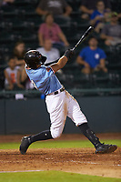 Pedro Gonzalez (4) of the Hickory Crawdads follows through on his swing against the Charleston RiverDogs at L.P. Frans Stadium on August 10, 2019 in Hickory, North Carolina. The RiverDogs defeated the Crawdads 10-9. (Brian Westerholt/Four Seam Images)