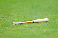 A baseball bat lies in the grass during the Carolina League game between the Lynchburg Hillcats and the Winston-Salem Dash at BB&T Ballpark on August 5, 2013 in Winston-Salem, North Carolina.  The Dash defeated the Hillcats 5-0.  (Brian Westerholt/Four Seam Images)