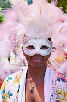 Beautiful African-American Girl Wearing Pink Feathered Mask, Fremont Solstice Parade & Festival, Seattle, WA, USA.
