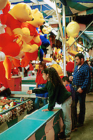 Carnival midway at annual Jalapeno festival near the Texas Mexico border. Stuffed animals. Coin toss game. Laredo Texas.