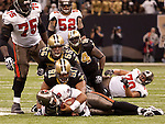 December 2009:New Orleans Saints defensive end Will Smith (91) sacks Tampa Bay Buccaneers quarterback Josh Freeman (5) during an NFL football game at the Louisiana Superdome in New Orleans.