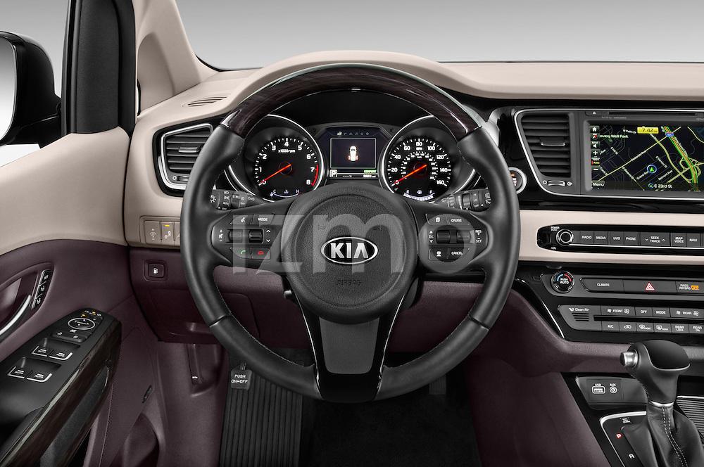 Car pictures of steering wheel view of a 2015 KIA Sedona SX Limited 4 Door Minivan Steering Wheel