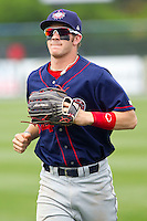 Right fielder Bryce Harper #34 of the Hagerstown Suns jogs off the field at the end of an inning during the game against the Rome Braves at State Mutual Stadium on May 1, 2011 in Rome, Georgia.   Photo by Brian Westerholt / Four Seam Images