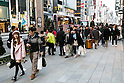 Asian tourists shopping in Tokyo ahead of the Chinese New Year