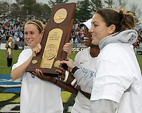 Heather O'Reilly, Robyn Gayle, Jessica Maxwell with trophy.UNC-Chapel Hill vs Notre Dame in 2006 NCAA Women's College Cup at SAS Stadium in Cary, NC