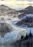 The Nenana River appears to smoke as steam rises during a bitter cold snap near Denali National Park, Alaska.