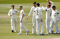 16th April 2021; Emirates Old Trafford, Manchester, Lancashire, England; English County Cricket, Lancashire versus Northants;  Luke Wood of Lancashire (second left) celebrates with his team mates after his dismissal of Ricardo Vasconcelos of Northamptonshire