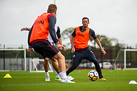 Wednesday 26 July 2017<br /> Pictured: Gylfi Sigurdsson of Swansea City  ( right ) in action during training <br /> Re: Swansea City FC Training session takes place at the Fairwood Training Ground, Swansea, Wales, UK