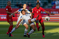 CARSON, CA - FEBRUARY 07: Raquel Rodriguez #11 of Costa Rica shoots past Kadeisha Buchanan #3 of Canada during a game between Canada and Costa Rica at Dignity Health Sports Park on February 07, 2020 in Carson, California.