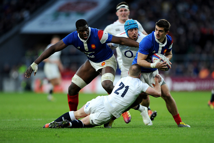 Thomas Ramosca of France looks for support as he is tackled by Dan Robson and Jack Nowell of England during the Guinness Six Nations match between England and France at Twickenham Stadium on Sunday 10th February 2019 (Photo by Rob Munro/Stewart Communications)