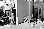Woman leaving the Desert Inn Motel, Calico California USA  1971