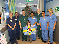 Pictured: Elly Neville (C) with Withybush Hospital staff<br /> Re: Seven-year-old Elly Neville who was born despite doctors saying her parents would not be able to have any more children, has raised over £150,000 for the cancer ward that treated her father.<br /> Her parents Lyn and Ann had been told they were unlikely to have more children after he underwent a bone marrow transplant in 2005. <br /> Mr Neville subsequently spent a lot of time on the Ward 10 cancer facility at Withybush Hospital in Haverfordwest, Pembrokeshire.<br /> But four years later they were stunned when his painter and decorator wife Ann fell pregnant again.