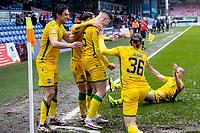 13th March 2021; Global Energy Stadium, Dingwall, Highland, Scotland; Scottish Premiership Football, Ross County versus Hibernian; Kevin Nisbet of Hibernian celebrates after scoring Hibs second goal to make it 2-1 to Hibs with team mates in the 60th minute