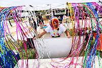 PRIDE FESTIVAL<br />Anna Miller sets up a booth on Saturday June 5 2021 during the Bentonville Pride Festival at The Momentary in Bentonville. The festival featured performances, information, food and music in support of the LBGTQIQ+ community in partnership with the Northwest Arkansas Women's Shelter. The fair hoped to bring awareness to the diproportionate rate of domestic violence against this community. Go to nwaonline.com/210606Daily/ to see more photos.<br />(NWA Democrat-Gazette/Flip Putthoff)