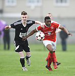 Daniel O Neill of Janesboro in action against Tino Nzvaura of Newmarket Celtic during their Munster Junior Cup semi-final at Limerick. Photograph by John Kelly.