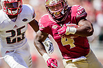 Florida State running back Dalvin Cook outruns Louisville's Josh Harvey-Clemons on a14 yard touchdown  in the second half of an NCAA college football game in Tallahassee, Fla., Saturday, Oct. 17, 2015. Florida State defeated Louisville 41-21. (AP Photo/Mark Wallheiser)