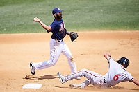 Binghamton Mets shortstop Amed Rosario (1) turns a double play as Hunter Cole (6) slides in during a game against the Richmond Flying Squirrels on June 26, 2016 at NYSEG Stadium in Binghamton, New York.  Binghamton defeated Richmond 7-2.  (Mike Janes/Four Seam Images)