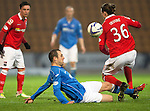 St Johnstone v Ross County....29.11.14   Scottish Cup 4th Round<br /> Dave Mackay tackles Jackson Irvine<br /> Picture by Graeme Hart.<br /> Copyright Perthshire Picture Agency<br /> Tel: 01738 623350  Mobile: 07990 594431