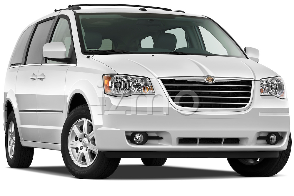Low aggressive passenger side front three quarter view of a 2010 Chrysler Town and Country Touring.