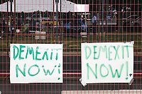 """Signs read """"DEMEXIT"""" on the fence on the outside of the secure area surrounding the Democratic National Convention at the Wells Fargo Center in Philadelphia, Pennsylvania, on Wed., July 27, 2016. """"DEMEXIT"""" is likely a reference to """"Brexit"""" and the walkout from the DNC by Bernie Sanders supporters."""