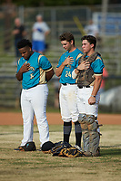 (L-R) Jermie Greene (6) (Caldwell CC), Maddux Holshouser (xx) (UNC Greensboro) and Davis Turner (21) (Lenoir Rhyne) of the Mooresville Spinners stand for the National Anthem prior to the game against the Lake Norman Copperheads at Moor Park on July 6, 2020 in Mooresville, NC.  The Spinners defeated the Copperheads 3-2. (Brian Westerholt/Four Seam Images)
