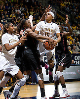 Berkeley, CA - March 4th, 2012: Nnemkadi Ogwumike of Stanford tries to block California's Brittany Boyd's shot during a basketball game against California in Berkeley, California.   Stanford won, 86-61.