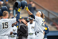 Michigan Wolverines outfielder Jordan Brewer (22) crosses the plate after hitting a home run against the Rutgers Scarlet Knights on April 27, 2019 in the NCAA baseball game at Ray Fisher Stadium in Ann Arbor, Michigan. Michigan defeated Rutgers 10-1. (Andrew Woolley/Four Seam Images)