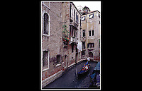 Venice - Italy - June 1997 -<br /> <br /> The city is built on an archipelago of 117 islands formed by 177 canals in a shallow lagoon. In the old centre, the canals serve the function of roads. Venice is Europe's largest urban car free area.