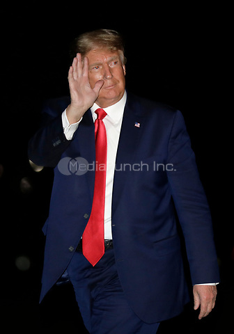 United States President Donald J. Trump waves as he walks on the South Lawn of the White House upon his return to Washington, DC from Georgia on October 16, 2020. <br /> Credit: Yuri Gripas / Pool via CNP / MediaPunch