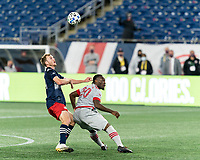 FOXBOROUGH, MA - OCTOBER 7: Henry Kessler #4 of New England Revolution and Ayo Akinola #20 of Toronto FC battle for head ball during a game between Toronto FC and New England Revolution at Gillette Stadium on October 7, 2020 in Foxborough, Massachusetts.