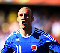 Robert Vittek of Slovakia celebrates scoring the opening goal against New Zealand