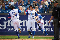 Wilmington Blue Rocks Roman Collins (34) high fives Anderson Miller (24) after scoring a run during the first game of a doubleheader against the Frederick Keys on May 14, 2017 at Daniel S. Frawley Stadium in Wilmington, Delaware.  Wilmington defeated Frederick 10-2.  (Mike Janes/Four Seam Images)